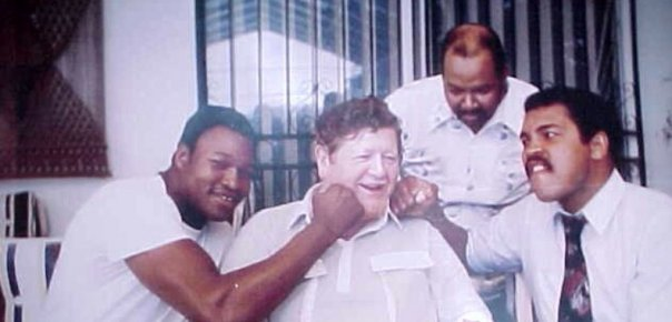 "L-R George Logan (L) & Muhammad Ali (R) ""punching"" Dad (center)"